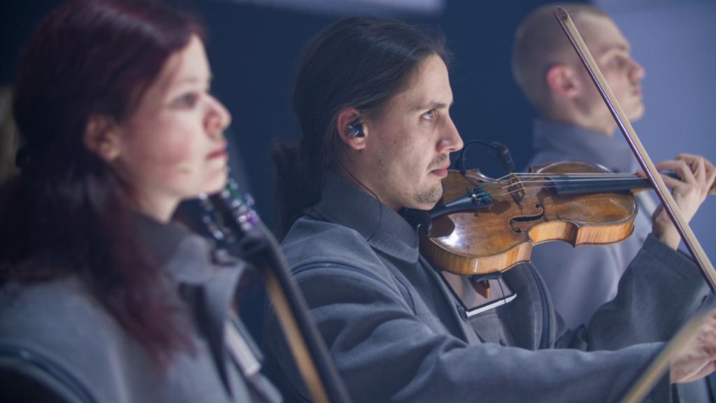 Closeup of Maya Fridman (cello) and Noah Eyl (violin)